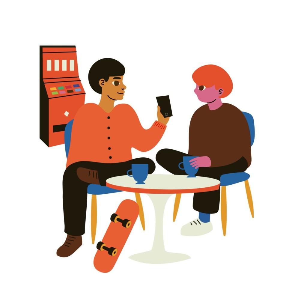 Nuoria istuskelemassa. pöydällä muiden tavaroiden joukossa nuuskapurkki. Taustalla rahapeliautomaatti.